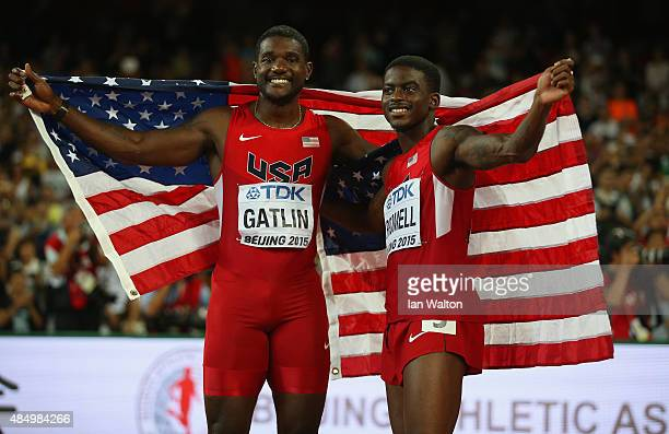 Silver medalist Justin Gatlin of the United States and bronze medalist Trayvon Bromell of the United States celebrate after the Men's 100 metres...