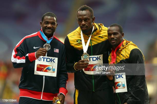 Silver medalist Justin Gatlin of the United States gold medalist Usain Bolt of Jamaica and bronze medalist Nesta Carter of Jamaica stand on the...
