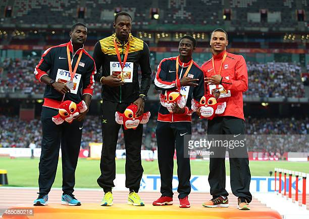 Silver medalist Justin Gatlin of the United States gold medalist Usain Bolt of Jamaica and joint bronze medalists Trayvon Bromell of the United...