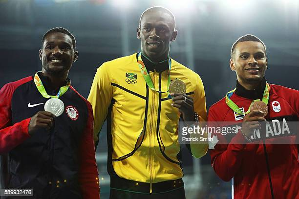 Silver medalist Justin Gatlin of the United States gold medalist Usain Bolt of Jamaica and bronze medalist Andre de Grasse of Canada pose on the...
