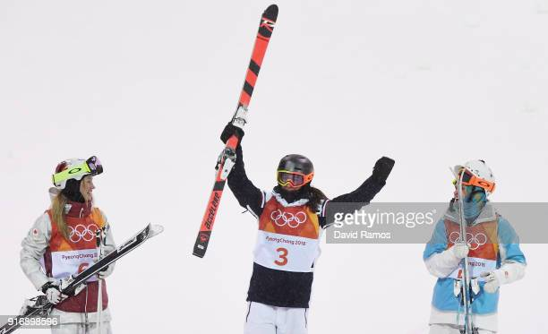 Silver medalist Justine DufourLapointe of Canada gold medalist Perrine Laffont of France and bronze medalist Yulia Galysheva of Kazakhstan celebrate...