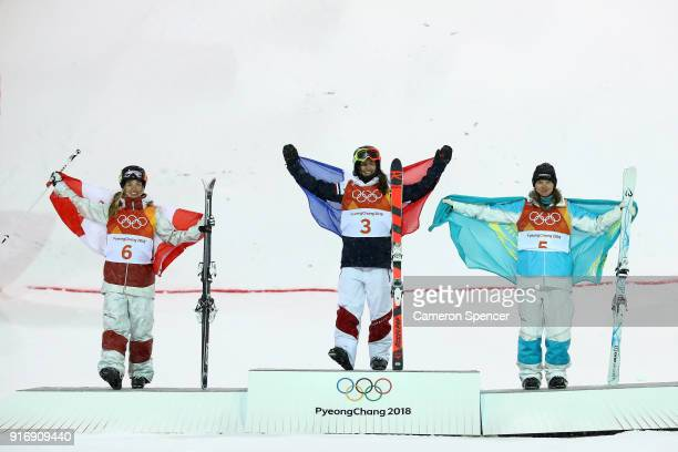 Silver medalist Justine DufourLapointe of Canada gold medalist Perrine Laffont of France and bronze medalist Yulia Galysheva of Kazakhstan pose...