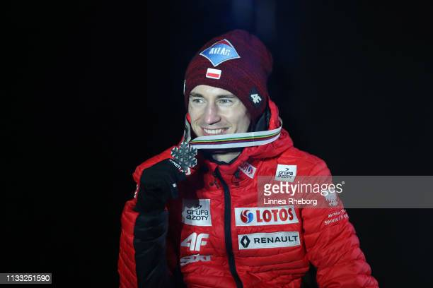 Silver medalist Kamil Stoch of Poland celebrates with his medal during the Medal Ceremony for Individual Ski Jumping HS109 competition during the FIS...