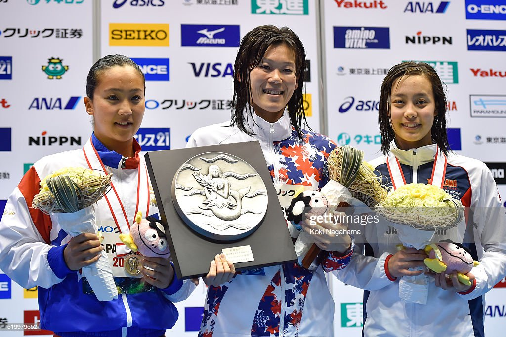 Silver medalist Kanako Watanabe, gold medalist Rie Kaneto and bronze medalist Runa Imai pose for photographs after the Women's 200m Breaststroke final during the Japan Swim 2016 at Tokyo Tatsumi International Swimming Pool on April 9, 2016 in Tokyo, Japan.