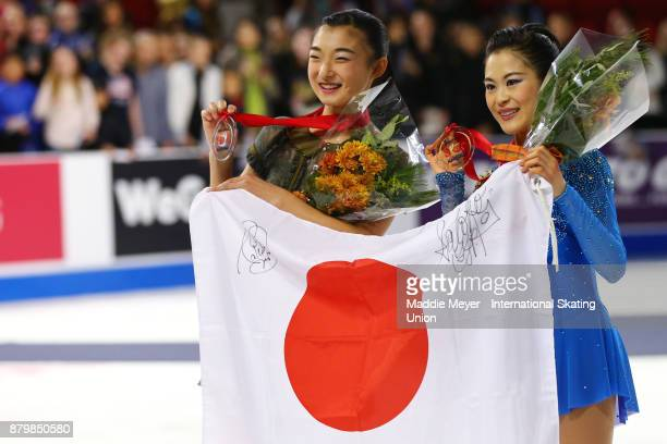 Silver medalist Kaori Sakamoto of Japan and gold medalist Satoko Miyahara of Japan celebrate after the conclusion of the Ladies program on Day 3 of...