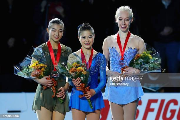 Silver medalist Kaori Sakamoto of Japan gold medalist Satoko Miyahara of Japan and bronze medalist Bradie Tennell of the United States pose after...