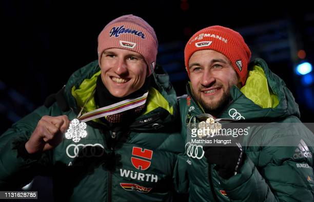 Silver medalist Karl Geiger of Germany and Gold medalist Markus Eisenbichler of Germany celebrate with their medals during the medal ceremony for the...
