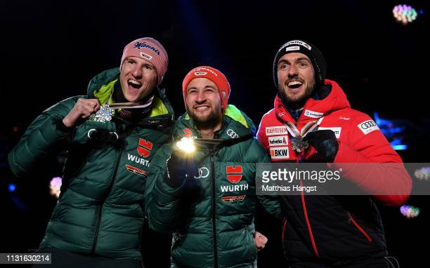 Silver medalist Karl Geiger of Germany Gold medalist Markus Eisenbichler of Germany and Bronze medalist Killian Peier of Switzerland celebrate with...