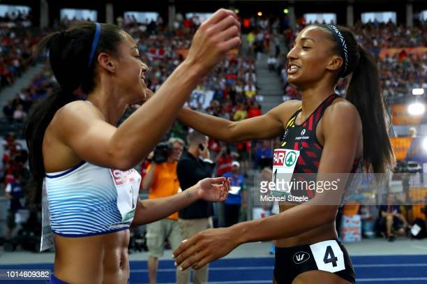 Silver medalist Katarina JohnsonThompson of Great Britain congratulates Nafissatou Thiam of Belgium on winning Gold in the Women's Heptathlon during...