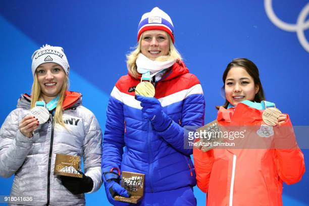Silver medalist Katharina Althaus of Germany gold medalist Maren Lundby of Norway and bronze medalist Sara Takanashi of Japan pose during the medal...