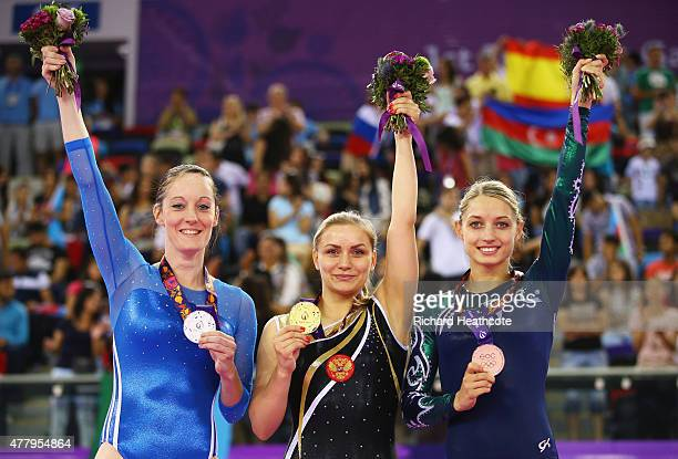 Silver medalist Katherine Driscoll of Great Britain gold medalist Yana Pavlova of Russia and bronze medlaist Hanna Harchonak of Belarus stand on the...