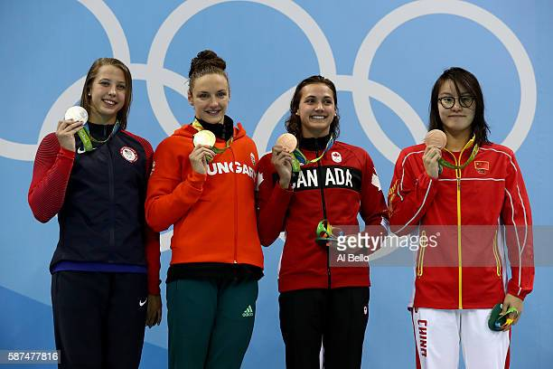 Silver medalist Kathleen Baker of the United States gold medal medallist Katinka Hosszu of Hungary and bronze medalist's Kylie Masse of Canada and...