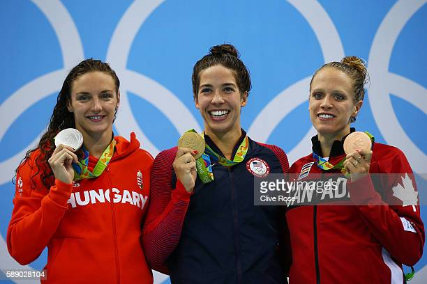 Silver medalist Katinka Hosszu of Hungary gold medalist Madeline Dirado of the United States and bronze medalist Hilary Caldwell of Canada pose on...