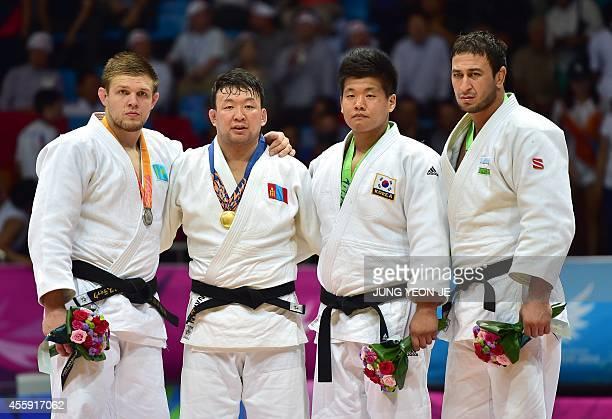 Silver medalist Kazakhstan's Maxim Rakov gold medalist Mongolia's Tuvshinbayar Naidan bronze medalists South Korea's Cho GuHam and Uzbekistan's...