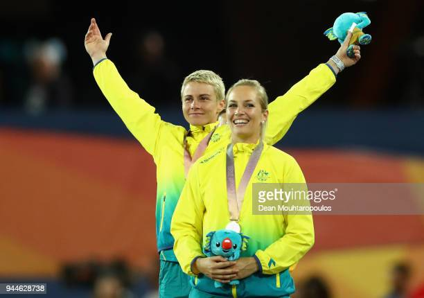 Silver medalist KelseyLee Roberts of Australia and gold medalist Kathryn Mitchell of Australia look on during the medal ceremony for the Women's...