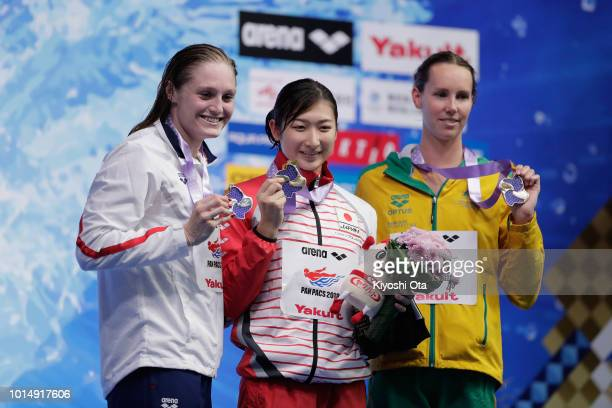 Silver medalist Kelsi Dahlia of the United States gold medlist Rikako Ikee of Japan and bronze medalist Emma McKeon of Australia celebrate on the...