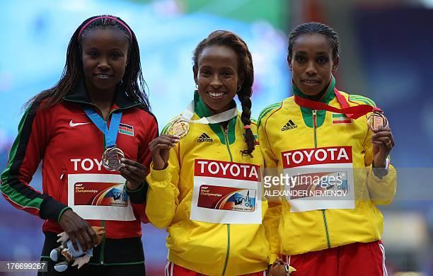 Silver medalist Kenya's Mercy Cherono, gold medalist Ethiopia's Meseret Defar and bronze medalist Ethiopia's Almaz Ayana pose on the podium during...