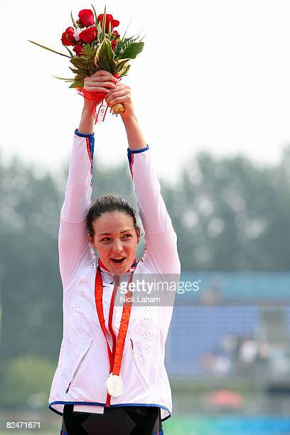 Silver medalist KeriAnne Payne of Great Britain celebrates on the podium during the medal ceremony for the Women's Marathon 10km swimming event at...