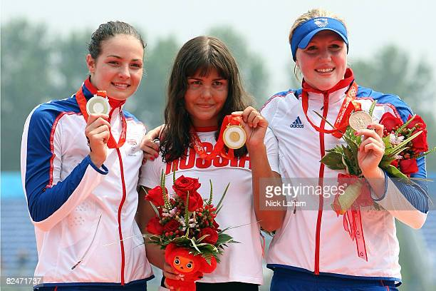 Silver medalist KeriAnne Payne of Great Britain gold medalist Larisa Ilchenko of Russia and bronze medalist Cassandra Patten of Great Britain pose on...