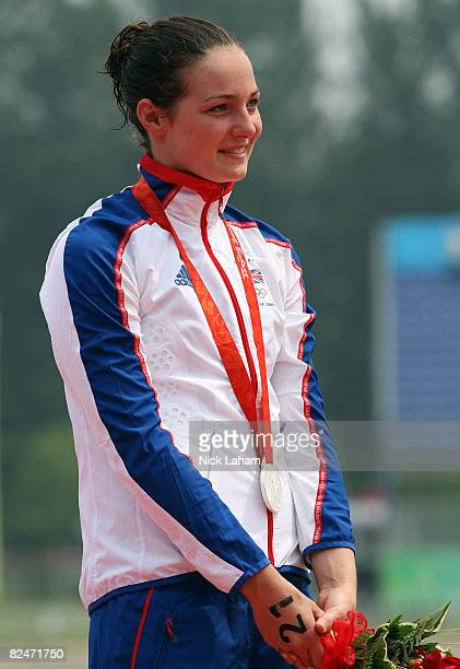 Silver medalist KeriAnne Payne of Great Britain stands on the podium during the medal ceremony for the Women's Marathon 10km swimming event at the...