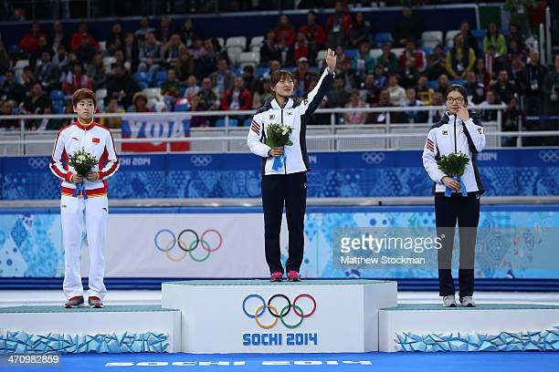 Silver medalist Kexin Fan of China gold medalist SeungHi Park of South Korea and bronze medalist Suk Hee Shim of South Korea celebrate on the podium...