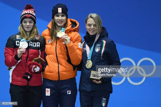 Silver medalist Kim Boutin of Canada gold medalist Suzanne Schulting of the Netherlands and bronze medalist Arianna Fontana of Italy celebrate during...