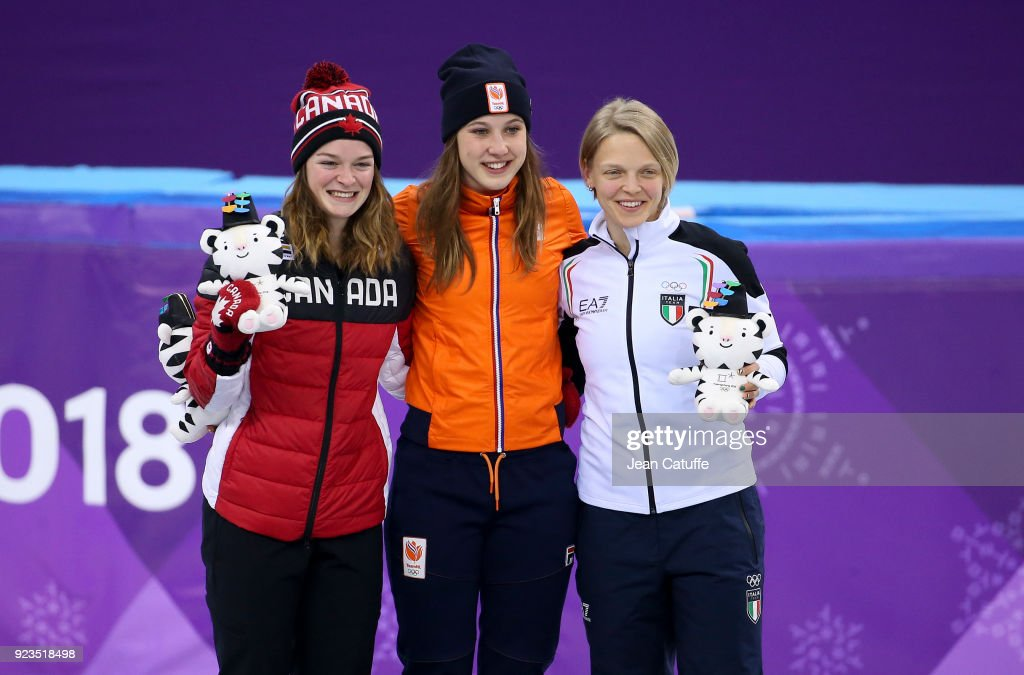 Silver medalist Kim Boutin of Canada, Gold medalist Suzanne Schulting of the Netherlands and Bronze medalist Arianna Fontana of Italy celebrate during ceremony following the Short Track Speed Skating Women's 1000m Final A on day thirteen of the PyeongChang 2018 Winter Olympic Games at Gangneung Ice Arena on February 22, 2018 in Gangneung, South Korea.