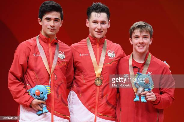 Silver medalist Kim Daybell of England, gold medalist Ross Wilson of England and bronze medalist Joshua Stacey of Wales pose during the medal...