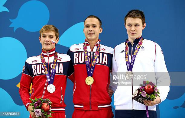 Silver medalist Kirill Mordashev of Russia gold medalist Anton Chupkov of Russia and bronze medalist Luke Davies of Great Britain stand on the podium...