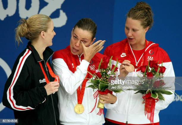 Silver medalist Kirsty Coventry of Zimbabwe gold medalist Natalie Coughlin of the United States and bronze medalist Margaret Hoelzer of the United...