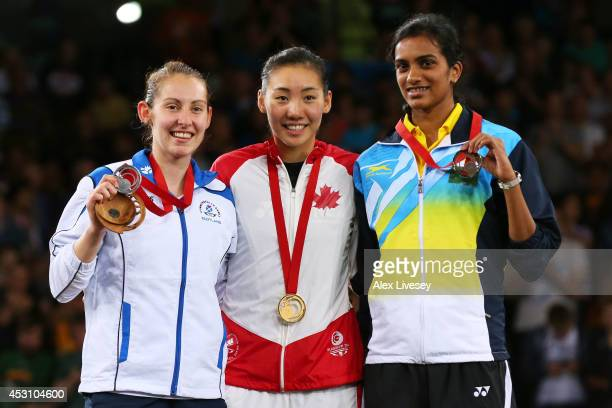 Silver medalist Kirsty Gilmour of Scotland gold medalist Michelle Li of Canada and bronze medalist PV Sindhu of India pose in the medal ceremony for...