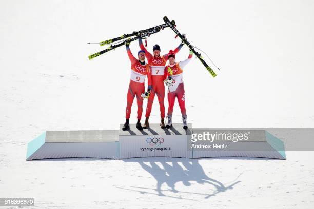 Silver medalist Kjetil Jansrud of Norway gold medalist Aksel Lund Svindal of Norway and bronze medalist Beat Feuz of Switzerland celebrate on the...