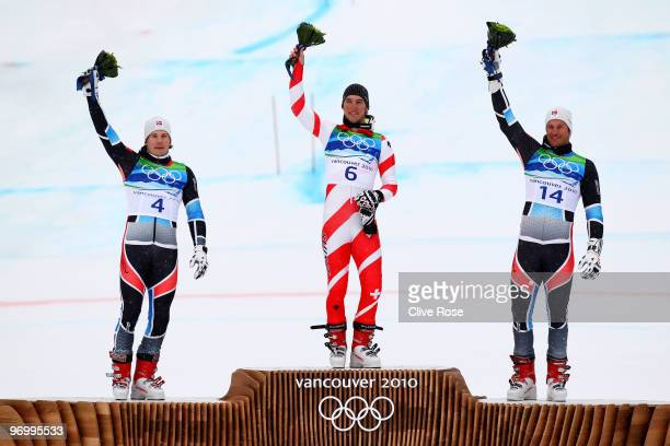 Silver medalist Kjetil Jansrud of Norway gold medalist Carlo Janka of Switzerland and bronze medalist Aksel Lund Svindal of Norway celebrate after...