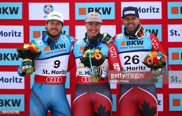 Silver medalist Kjetil Jansrud of Norway gold medalist Erik Guay of Canada and bronze medalist Manuel OsborneParadis of Canada pose during the flower...