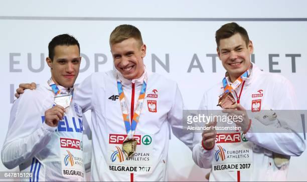 Silver medalist Konstandinos Filippidis of Greece gold medalist Piotr Lisek of Poland and bronze medalist Pawel Wojciechowski of Poland pose during...