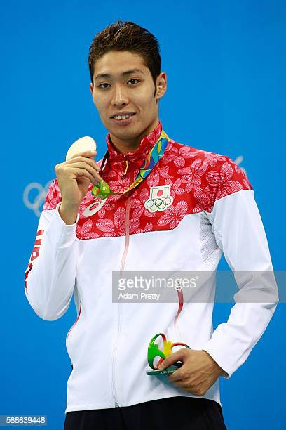 Silver medalist Kosuke Hagino of Japan celebrates during the medal ceremony for the Men's 200m Individual Medley Final on Day 6 of the Rio 2016...