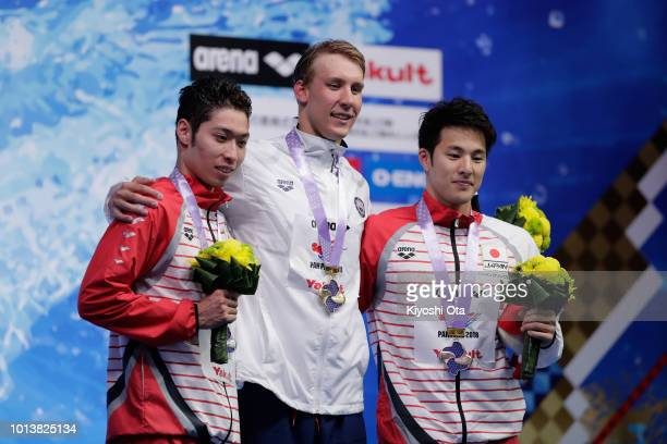 Silver medalist Kosuke Hagino of Japan gold medalist Chase Kalisz of the United States and bronze medalist Daiya Seto of Japan pose for photographs...