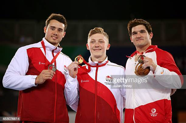 Silver medalist Kristian Thomas of England poses with Gold medalist Nile Wilson of England and Bronze medalist Kevin Lytwyn of Canada during the...