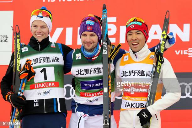 Silver medalist Kristjan Ilves of Estonia gold medalist Jan Schmid of Norway and bronze medalist Akito Watabe of Japan celebrate on the podium at the...