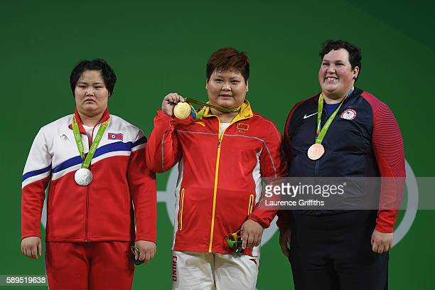 Silver medalist Kuk Hyang Kim of North Korea Gold medalist Suping Meng of China and bronze medalist Sarah Elizabeth Robles of the United States pose...