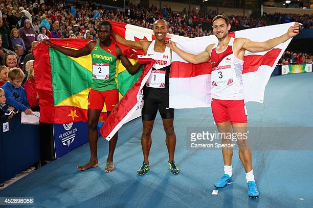 Silver medalist Kurt Felix of Grenada gold medalist Damian Warner of Canada and silver medalist Ashley Bryant of England pose after the Men's...