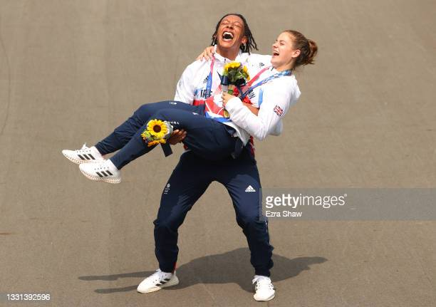 Silver medalist Kye Whyte and gold medalist Bethany Shriever of Team Great Britain pose for a photograph while celebrate at the medal ceremony after...
