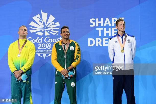 Silver medalist Kyle Chalmers of Australia silver medalist Chad le Clos of South Africa and gold medalist Duncan Scott of Scotland pose during the...
