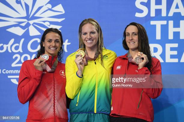 Silver medalist Kylie Masse of Canada gold medalist Emily Seebohm of Australia and bronze medalist Georgia Davies of Wales pose during the medal...