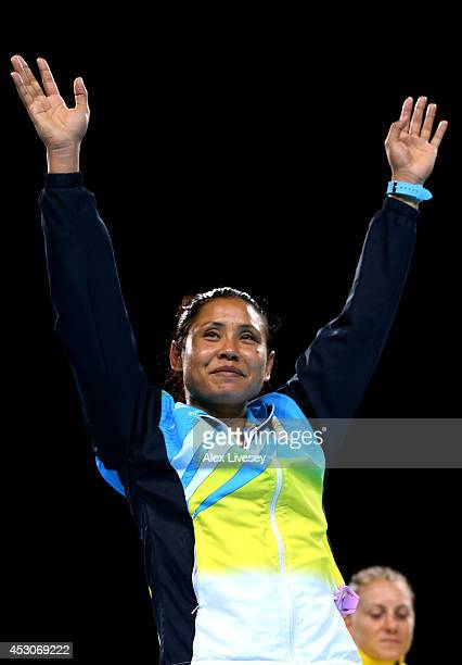 Silver medalist Laishram Devi of India celebrates during the medal ceremony for the Women's Light Final at SSE Hydro during day ten of the Glasgow...