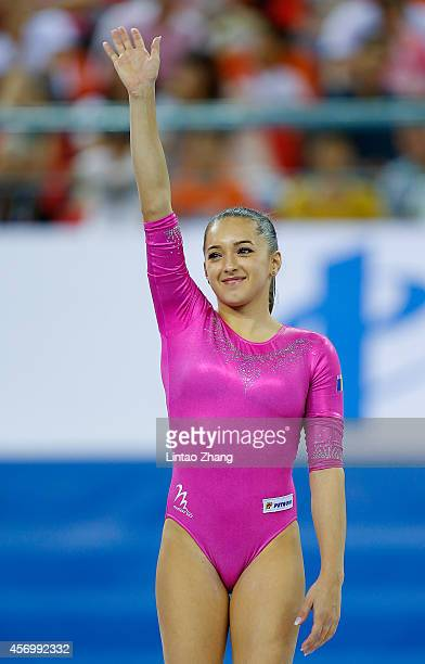 Silver medalist Larisa Andreea Iordache of Romania celebrates during the medal ceremony after the Women's AllAround Final in day four of the 45th...