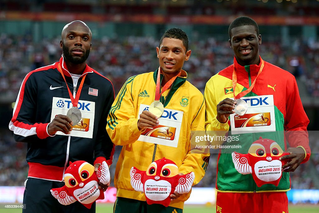 Silver medalist Lashawn Merritt of the United States, gold medalist Wayde Van Niekerk of South Africa and bronze medalist Kirani James of Grenada pose on the podium during the medal ceremony for the Men's 400 metres final during day six of the 15th IAAF World Athletics Championships Beijing 2015 at Beijing National Stadium on August 27, 2015 in Beijing, China.