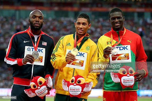 Silver medalist Lashawn Merritt of the United States gold medalist Wayde Van Niekerk of South Africa and bronze medalist Kirani James of Grenada pose...