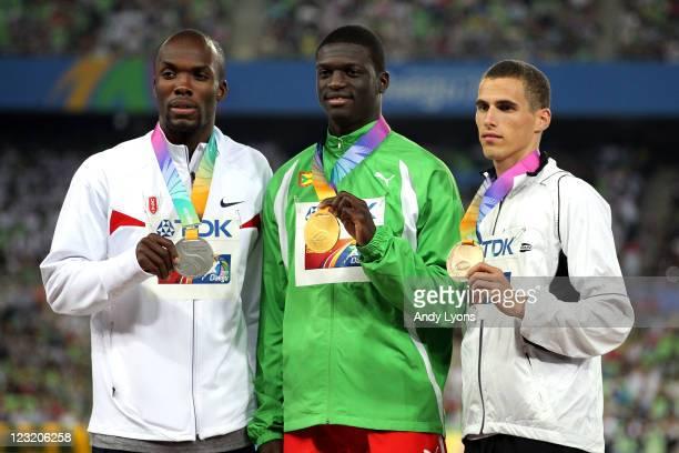 Silver medalist LaShawn Merritt of United States gold medalist Kirani James of Grenada and and bronze medalist Kevin Borlee of Belgium celebrate on...
