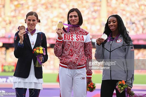 Silver medalist Lashinda Demus of the United States gold medalist Natalya Antyukh of Russia and bronze medalist Zuzana Hejnova of Czech Republic pose...